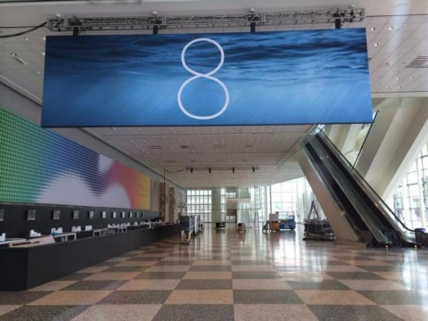 A banner for iOS 8 shows the number 8 against a watery background